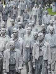 School employees act eerily similar to these zombie-like performance artists after the first day of school.