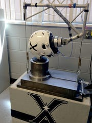 This image shows a Xenith manufactured football helmet going through impact testing at Xenith's new manufacturing facility in Southwest Detroit.