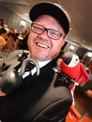 Travis DiNicola sported a pirate's hook and pet parrot for the Indy Reads 2014 Alphabet Affair celebrating the letter P.