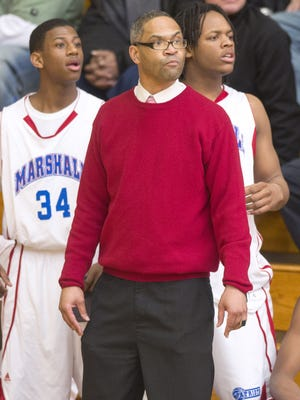 John Marshall High School head coach, Aaron Sembly,  watches the action from the bench during second-half action. Heritage Christian defeated Marshall 64-55. Indianapolis Broad Ripple High School hosted the second round of the IHSAA 2A Boys' Basketball Sectional 42 games between Heritage Christian and Indianapolis Marshall; Broad Ripple and Park Tudor, Friday, March 1, 2013. / Doug McSchooler/for The Star