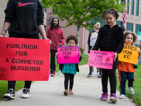 Demonstrators protest in downtown Sioux Falls, S.D.