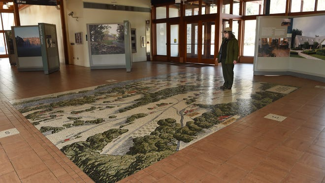 The mosaic tile pictorial floormap in the lobby of the Henry A. Wallace Visitor and Education Center.