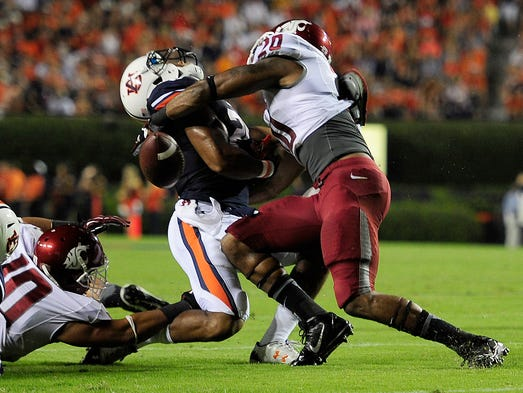 Auburn Tigers running back Tre Mason is tackled by Washington State Cougars safety Deone Bucannon on Aug. 31, 2013, at Jordan Hare Stadium.