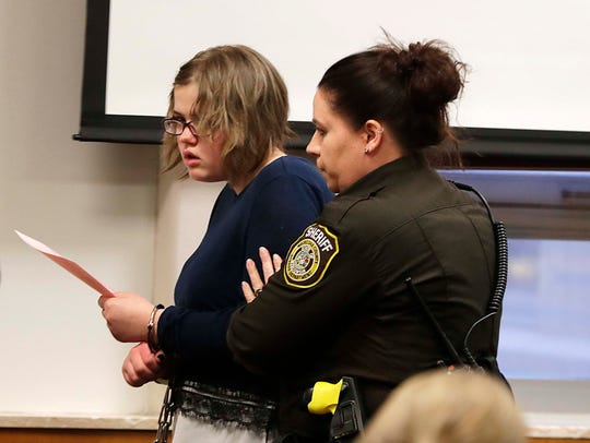 Morgan Geyser is escorted out of a Waukesha County