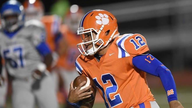 Madison Central quarterback Trey Smith scores the first touchdown of the game against Murrah on Friday, October 3, 2014, at Madison Central.