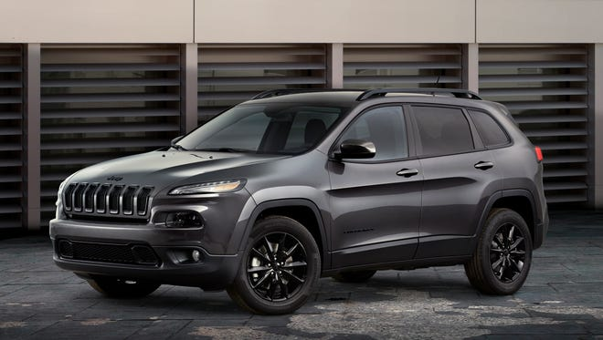 Mean-looking paint, wheel trearment show off the appeal of the 2014 Jeep Cherokee, which helped power the Chrysler Group's June sales to the best for that month since June 2007.