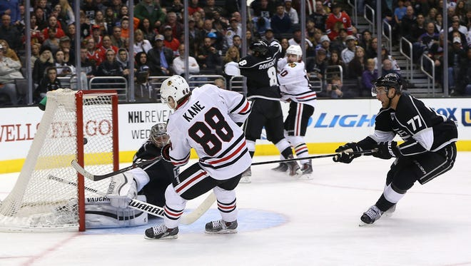 Chicago's Patrick Kane scores against Los Angeles' Jonathan Quick in February.