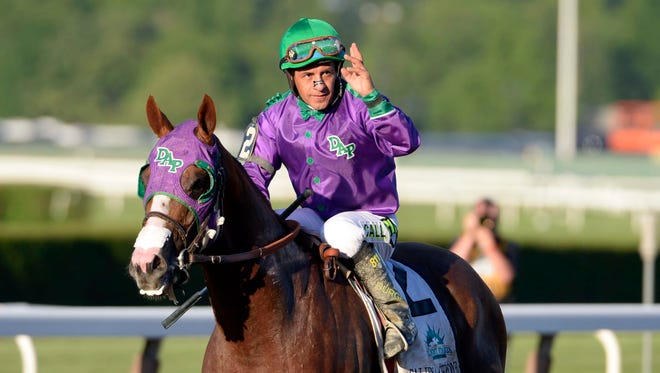Victor Espinoza aboard California Chrome reacts after finishing tied for fourth place during the 2014 Belmont Stakes at Belmont Park.