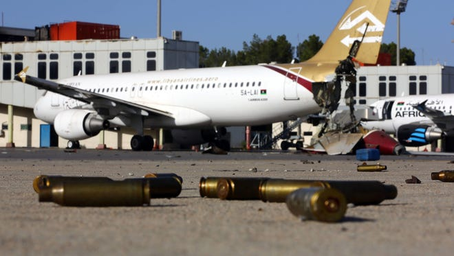 Bullet casings and damaged airplanes sit on the tarmac at Tripoli international airport on Aug. 26 after fighters from the Libyan Dawn coalition captured the airport.