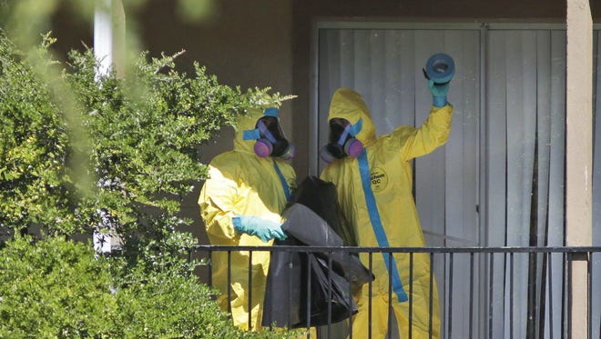 A hazardous-materials crew arrives at the apartment complex in Dallas where Thomas Eric Duncan, the Ebola patient who traveled from Liberia to Dallas, stayed last week.