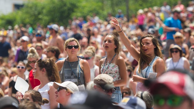 Fans sing along to Eric Paslay as he performs during the CMA Music Festival in Nashville, Tenn., Sunday, June 11, 2017.