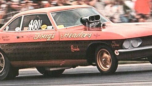 "The enhanced aerodynamic body of the Corvairs was popular with nitro funny car teams in the 1966 to 1969 era. Shown here is the Doug Thorley ""Doug's Headers"" Corvair that won the 1967 U.S Nationals running a Chevy big block engine instead of the popular MOPAR Hemi engines. It ran a 7.69 in the quarter-mile that day."