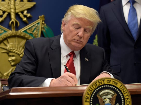 President Donald Trump signs an executive order on extreme vetting during an event at the Pentagon on Jan. 27, 2017.
