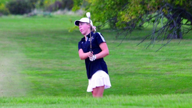 Macomb's Emma Thorman hits a shot during a golf tournament last fall.