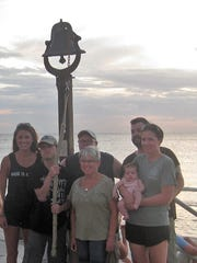 Largo resident Allison Rushing (center) and her family rang the Sunset Bell  in remembrance of her mother Doreen.