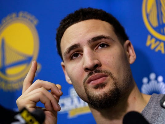 Golden State Warriors' Klay Thompson gestures during a news conference Monday, June 20, 2016, in Oakland, Calif. The Warriors lost to the Cleveland Cavaliers in Game 7 of basketball's NBA Finals on Sunday. (AP Photo/Ben Margot)