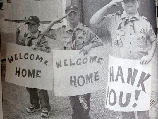 Uniontown Scouts were on hand to welcome four Marines on a Saturday in October of 2004. From left are Zane Quinn, Joseph Burke, and Michael Coble.