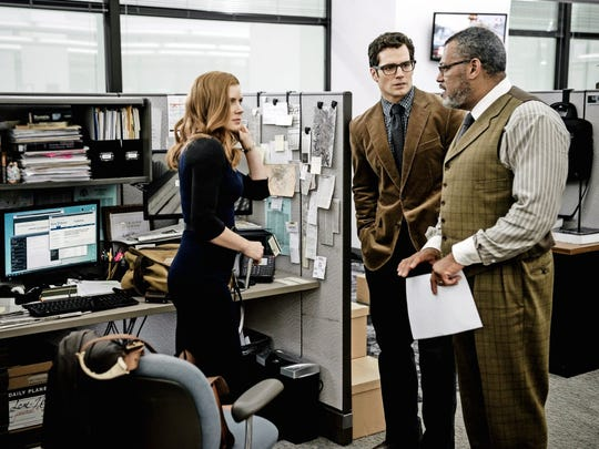 Clark Kent (Henry Cavill, center) has a newsroom confab