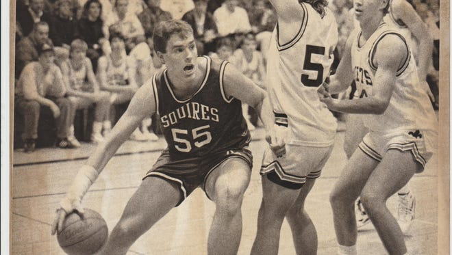 Kevin Rankin (55) was an all-state player for De Pere Abbot Pennings, which he led to the 1990 WISAA Class A state championship in the final year of the school. Rankin will be inducted into the Wisconsin Basketball Coaches Association Hall of Fame on Saturday in Wisconsin Dells.