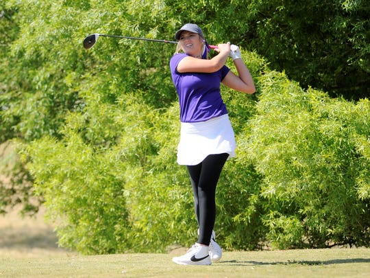 Wylie's Arin Zachary watches her tee shot from No. 15 during the first round of the Region I-4A tournament at the Shadow Hills Golf Course in Lubbock on April 25.