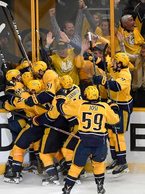 The Predators celebrate forward Kevin Fiala's overtime goal against the Chicago Blackhawks during the first round of the Stanley Cup playoffs in April.