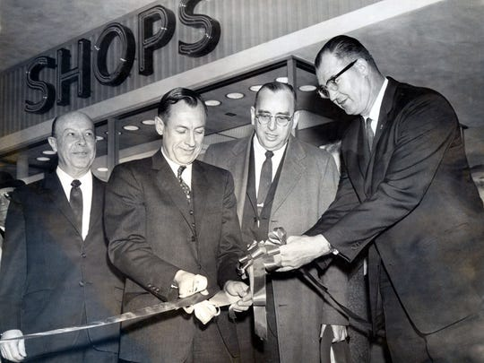 March 2, 1962 - OPEN BASSETT CENTER -- Mayor Ralph Seitsinger, second from left, officiates at ribbon-cutting ceremonies Thursday during the opening of the $7 million Bassett Center Thursday morning. On hand to give their approval are Charles N. Bassett Corp. officials, from left, H. M. Daugherty, president and director; George G. Matkin, vice president, treasurer and director, and Promotions Director Sam Rutherford.