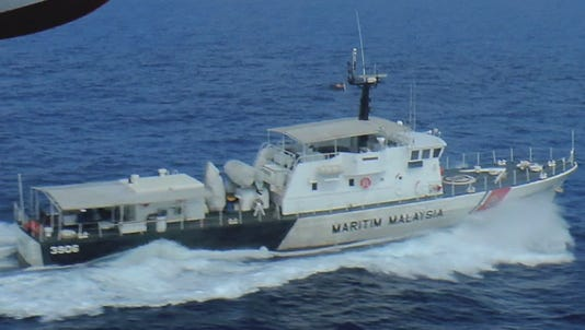 A photo taken from video shows a ship taking part in the search for a missing Malaysian plane.