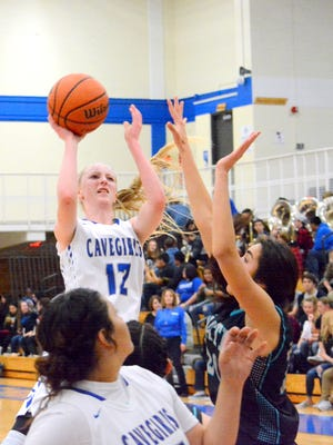 Carlsbad's Carsyn Boswell puts up a shot in the first quarter Friday.
