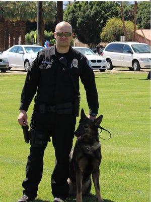 Zeus the police dog and his handler, Ofcr. Austin Studer.