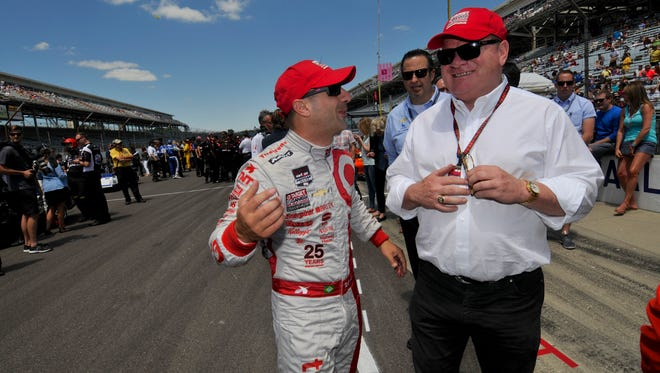 Tony Kanaan jokes with owner Chip Ganassi on a Saturday at the Indianapolis Motor Speedway.
