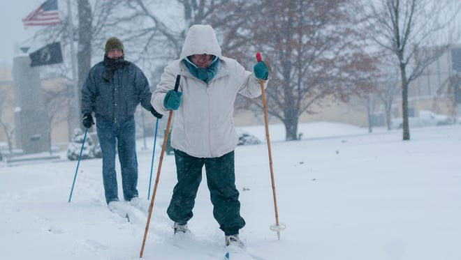 Amy and Kevin Baker cross country ski through Pine Grove Park Sunday, Dec. 11, in Port Huron.