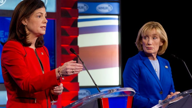 In this Nov. 2, 2016, photo, Sen. Kelly Ayotte, R-N.H., left, speaks as and Democratic challenger Gov. Maggie Hassan listens during a televised debate in Manchester, N.H. Control of the Senate hung in the balance Nov. 5 as candidates from Nevada to New Hampshire made their closing pitches to voters after a tough and costly campaign.