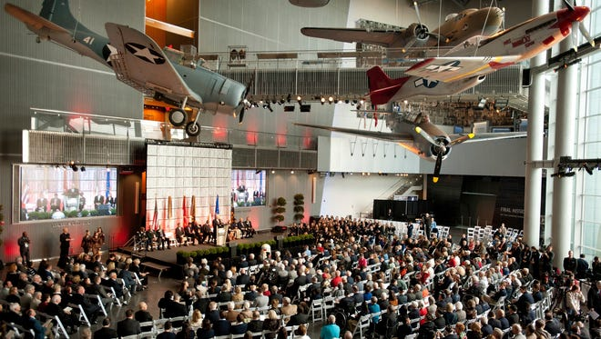 """FILE - This Dec. 12, 2014 file photo shows visitors attending the opening of The National World War II Museum's exhibit, entitled """"The Road to Berlin,"""" at the Boeing Freedom Pavilion, in New Orleans. Executives at the National World War II Museum say creating a vast online collection of 9,000 existing oral and written histories will take longer than the war was fought: 10 years and $11 million dollars. The task is enormous: thousands of hours of audio and video must be handled and millions of words transcribed."""
