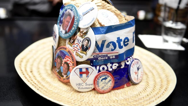 Franklin Delano Williams has collected buttons and stickers from every election since 1992 and displays them on this hat as he watched election results come in at the bar at the Hyatt House Hotel in Augusta, Ga., Tuesday evening November 3, 2020.