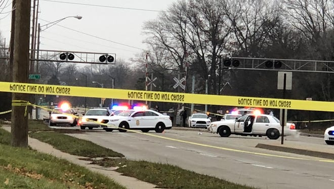 Police cordon off a crime scene on the south side of Indianapolis on Raymond Street Sunday, Dec. 24, 2017.
