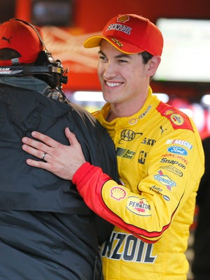 Joey Logano celebrates winning the pole for Sunday's NASCAR Sprint Cup Series auto race at Martinsville Speedway in Martinsville, Va., Friday, March 27, 2015. Rain delayed practice and qualifying. (AP Photo/Steve Helber)