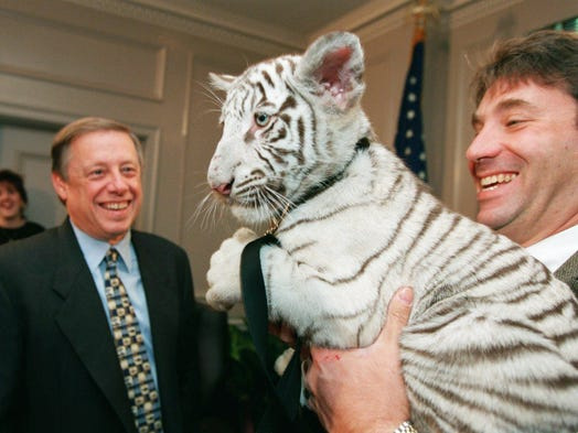 Nashville Zoo director Rick Schwartz holds Bena, an 11-week-old white Bengal tiger, after Mayor Phil Bredesen signed legislation Oct. 1, 1996, to bring the zoo to Nashville.