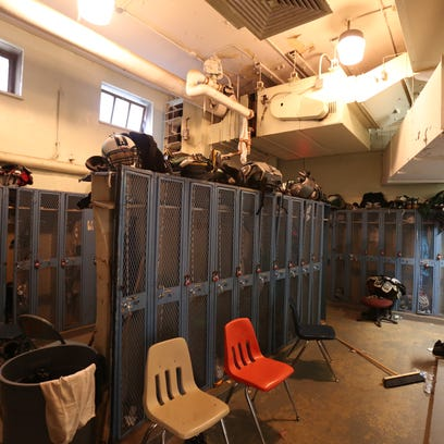 The crowded, poorly lit locker room at Gorton High