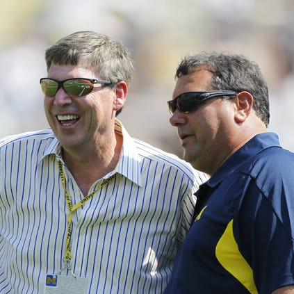 Michigan athletic director Dave Brandon, left, and football coach Brady Hoke, on Sept.  3,  2011.