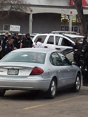 Police arrest a woman who was the suspect in a four-hour standoff in the Kmart parking lot.