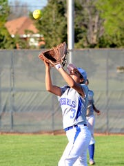Carlsbad second baseman Marissa Reyes tracks down the popup in the first game of Friday's District 4-6A doubleheader at Lady Wildcat Softball Field.