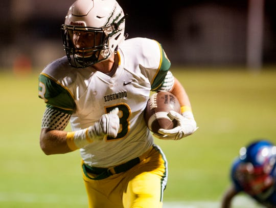 Edgewood's Jackson Tate (3) carries for a touchdown