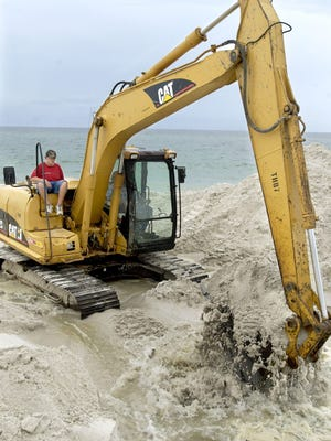 This is a file photo from the 2005 Pensacola Beach renourishment project. Mother Nature delayed Weeks Marine from laying submerged pipe Monday.