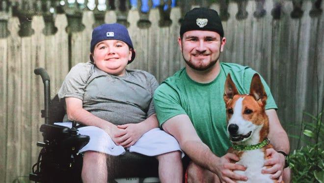 Kolten Fullenkamp, left, sits alongside his older brother, Braxton, and his beloved dog, Rudi Bo. Kolten Fullenkamp died Sunday after a car crash.