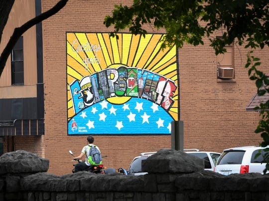 "A ""Greetings from Eclipseville"" mural graces a building"
