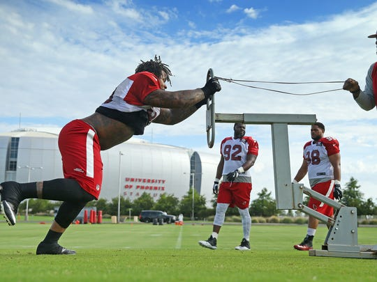 Cardinals defensive tackle Robert Nkemdiche (90) hits the sled during practice on Tuesday.