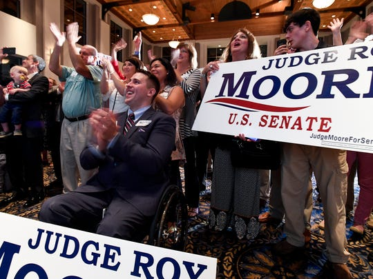 Fans of U.S. Senate candidate Roy Moore applause as he speaks during his election watch party at the Alabama Activity Center in downtown Montgomery, Ala., on Tuesday August 15, 2017.