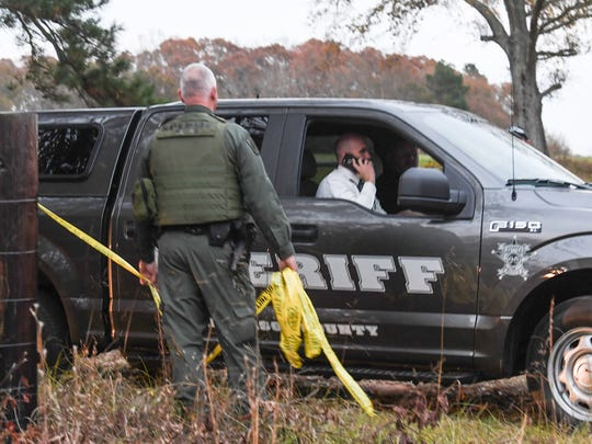 Anderson County Sheriff's Office investigators at the scene on Cleveland Road in Honea Path on Thursday evening.
