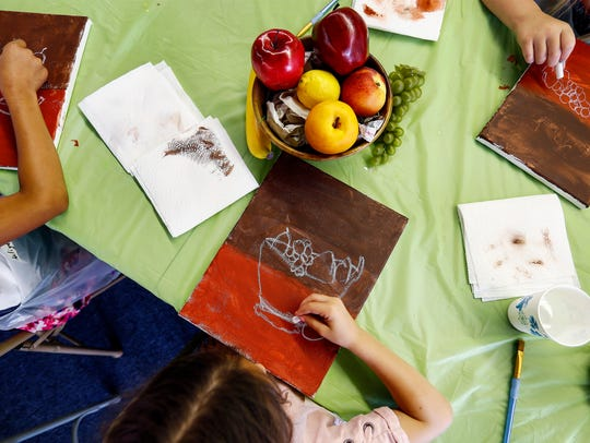 Campers at the Young at Art summer camp in Olive Branch trace an outline for a still life painting.
