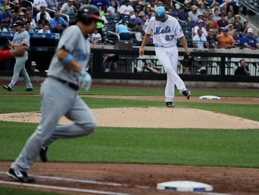 New York Mets relief pitcher Seth Lugo reacts as Washington Nationals' Jose Lobaton runs the bases after hitting a home run during the second inning of a baseball game, Saturday, June 17, 2017, in New York. (AP Photo/Frank Franklin II)